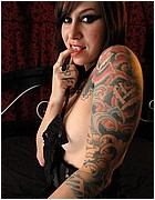 Tattooed Girl Spreads on Bed from Almost Evil Girls